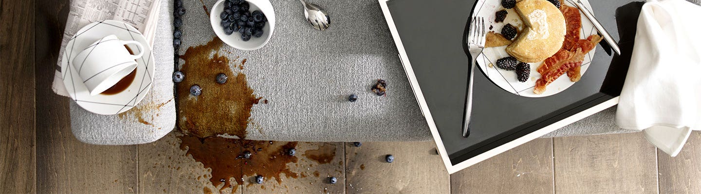 Breakfast spread coffee spill on upholstered furniture