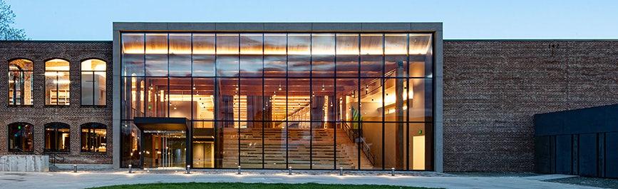 sunbrella headquarters brick building with glass facade