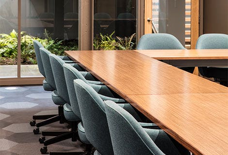 Conference room table with sunbrella fabric seats